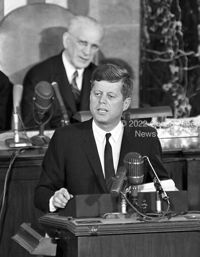 United States President John F. Kennedy delivers his State of the Union Address to a Joint Session of Congress at the U.S. Capitol in Washington, D.C. on Thursday, January 11, 1962.  Seated behind the President is the Speaker of the U.S. House of Representatives John W. McCormack (Democrat of Massachusetts).Credit: Arnie Sachs / CNP