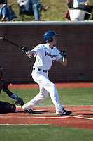 Mitch Farris (15) of the Wingate Bulldogs follows through on his swing against the Concord Mountain Lions at Ron Christopher Stadium on February 2, 2020 in Wingate, North Carolina. The Mountain Lions defeated the Bulldogs 12-11. (Brian Westerholt/Four Seam Images)
