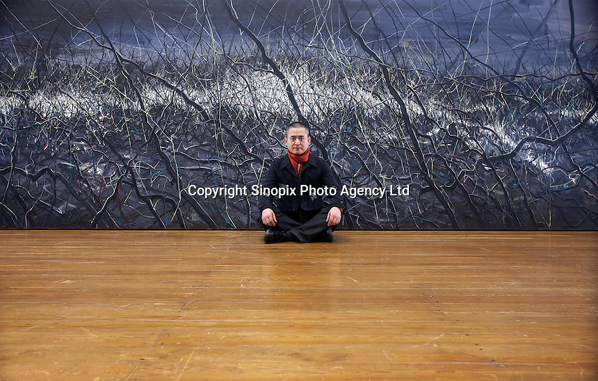 Zeng Fanzhi, China's renowned contemporary artist, poses for pictures  in his Beijing studio on 9th November, 2012, China. Zeng gained the title of &quot;Number One&quot; Chinese artist in terms of auction price in 2009.<br /> <br /> By Ricky Wong / Sinopix