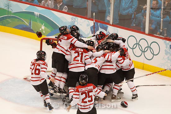 Trent Nelson  |  The Salt Lake Tribune.Team Canada swarms goalkeeper Canada's Shannon Szabados after the win. Canada defeats Team USA in the gold medal game, women's Ice Hockey at the Canada Hockey Place, Vancouver, XXI Olympic Winter Games, Thursday, February 25, 2010.