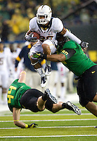 October 6th, 2011:  Isi Sofele of California tries to avoid being tackled by jumping over Oregon defenders during a game against Oregon Ducks at Autzen Stadium in Eugene, Oregon - Oregon defeated Cal 43 - 15