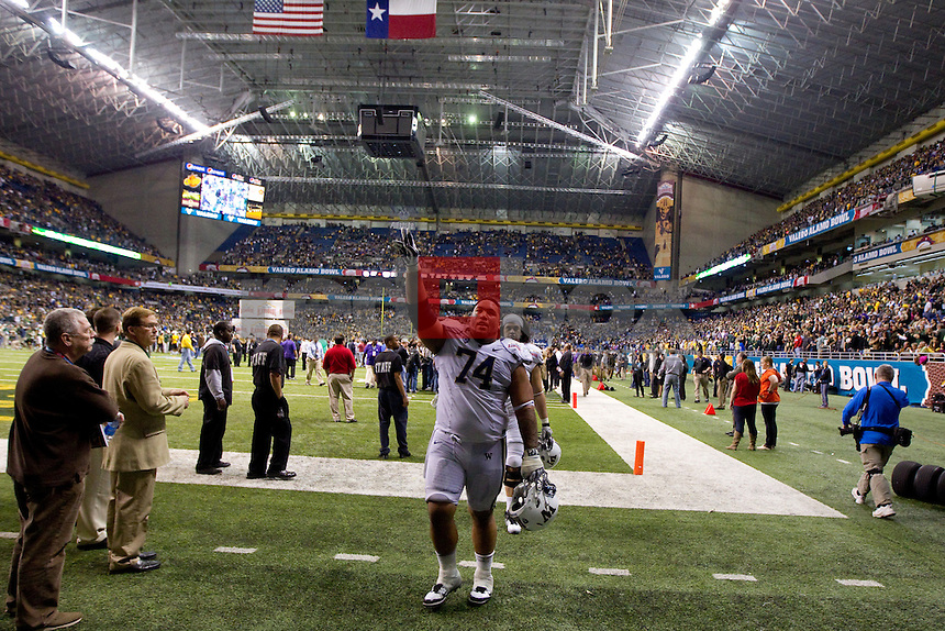 Alameda Ta'amu. The University of Washington Huskies lost to the Baylor University Bears 67-56 in the Valero Alamo Bowl at the Alamodome in San Antonio, Texas on Thursday December 29, 2011.(Photography By Scott Eklund/Red Box Pictures)