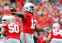Ohio State Buckeyes quarterback Cardale Jones (12) throws his second interception of the half to Northern Illinois Huskies cornerback Shawun Lurry (19) during the second quarter of the NCAA football game at Ohio Stadium in Columbus on Sept. 19, 2015. (Adam Cairns / The Columbus Dispatch)