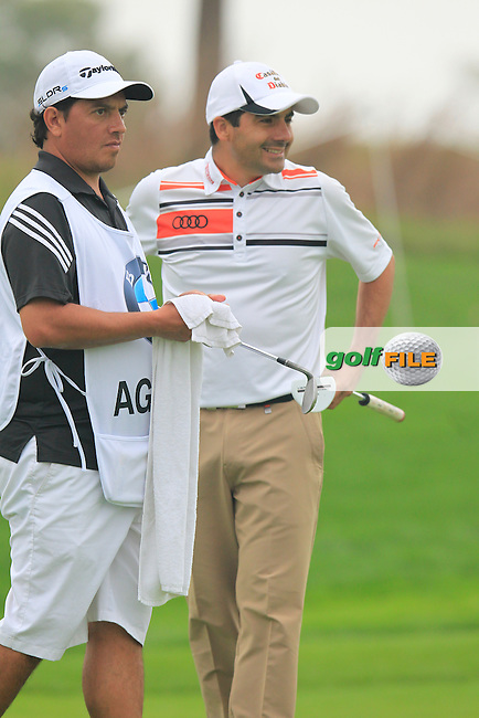 Felipe Aguilar (CHI) and caddy Omar on the 5th green during Saturay's Round 3 of the 2014 BMW Masters held at Lake Malaren, Shanghai, China. 1st November 2014.<br /> Picture: Eoin Clarke www.golffile.ie