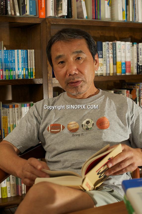 HARUKI MURAKAMI AT HIS OFFICE IN CENTRAL TOKYO