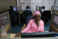 Agent at Warid's customer contact centre, Kampala. Operators typically speak English, Luganda, and another language - to cover Uganda as many as 20 lanuages are needed.