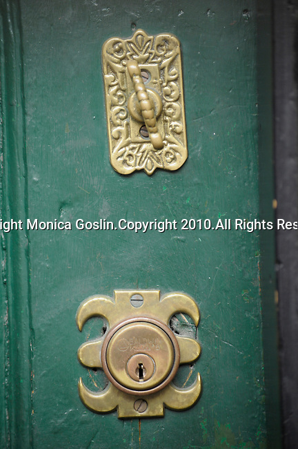 Detail of gold locks on a green door in Beacon Hill in Boston, MA.