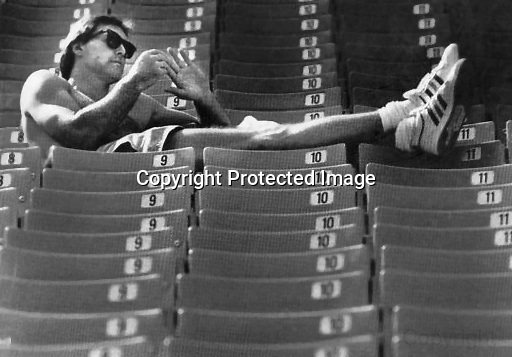 49er Dwight Clark enjoying the sun in the stands at Candlestick Park. Out of all 1980s fashion trends, the Ray-Ban sunglasses held up the best. Could be wrong, but I'm pretty sure those are the shoes from the Macy's fashion shoot, Jan. 18, 1989.