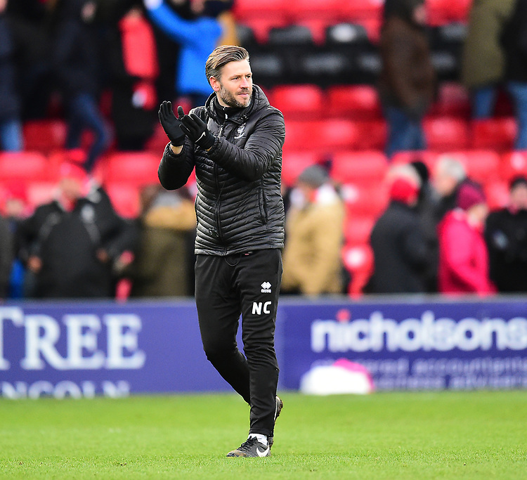 Lincoln City's assistant manager Nicky Cowley applauds the fans at the final whistle<br /> <br /> Photographer Andrew Vaughan/CameraSport<br /> <br /> The EFL Sky Bet League Two - Lincoln City v Grimsby Town - Saturday 19 January 2019 - Sincil Bank - Lincoln<br /> <br /> World Copyright &copy; 2019 CameraSport. All rights reserved. 43 Linden Ave. Countesthorpe. Leicester. England. LE8 5PG - Tel: +44 (0) 116 277 4147 - admin@camerasport.com - www.camerasport.com