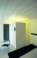 The entrance hall on the ground floor features a white cube which conceals a small bathroom