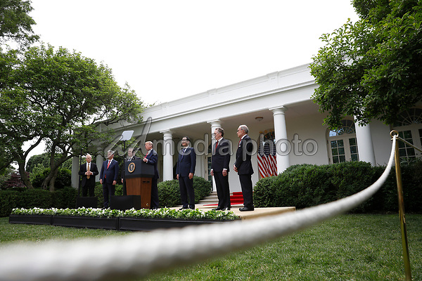 United States President Donald J. Trump with members of his administration delivers remarks on China in the Rose Garden at the White House in Washington, DC on May 29, 2020.  Pictured from left to right: Peter Navarro, Director of Trade and Industrial Policy and Director of the White House National Trade Council; US National Security Advisor Robert C. O'Brien; US Secretary of State Mike Pompeo; the president; US Secretary of the Treasury Steven T. Mnuchin; Ambassador Robert Lighthizer, US Trade Representative; and Director of the National Economic Council Larry Kudlow.<br /> Credit: Yuri Gripas / Pool via CNP/AdMedia