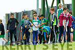 Young Kilmoyley and Cromane supporters wait for thr half time whistle so they can take some shots on the field at Austin Stack Park on Sunday
