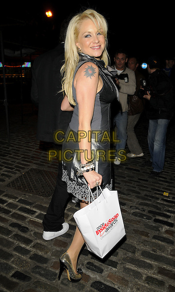 RITA SIMONS.2008 Inside Soap Awards held at The Stables, Camden Market, London, England, UK..September 29th, 2008. .full length black bow neck tattoo grey gray dress lace trim simmons goody bag .CAP/CAN.©Can Nguyen/Capital Pictures.