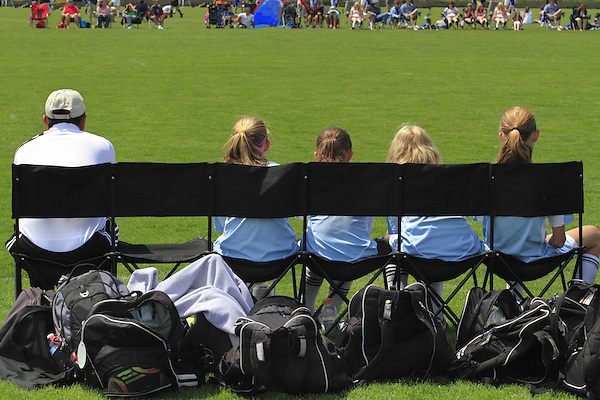 Coach with substitute players at soccer game, Denver, Colorado, USA. .  John leads private photo tours in Boulder and throughout Colorado. Year-round.