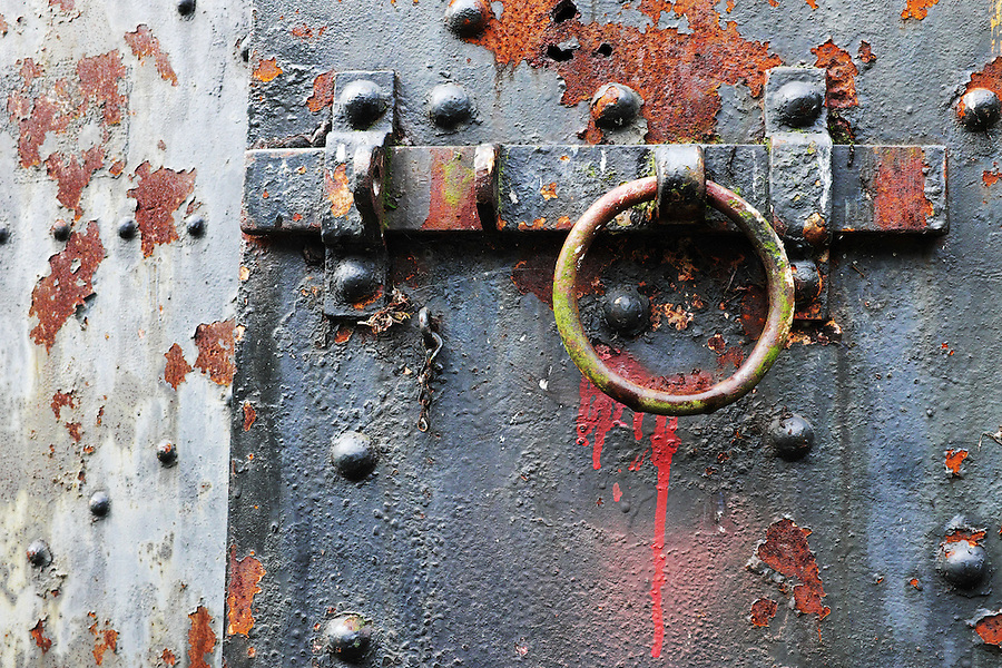 Rusty steel latch on steel bunker tunnel door, Artillery Hill, Fort Worden State Park, Port Townsend, Washington, USA