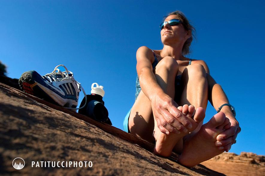 Female runner relaxing after a run in the Utah desert
