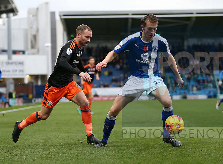 Matt Done of Sheffield Utd challenges Tom Anderson of Chesterfield during the English League One match at the Proact Stadium, Chesterfield. Picture date: November 13th, 2016. Pic Simon Bellis/Sportimage
