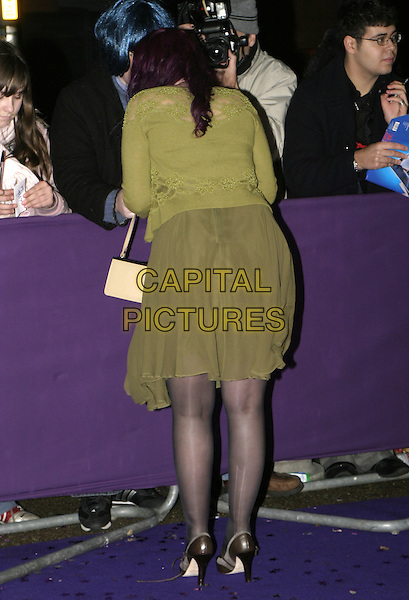 JANE GOLDMAN.British Comedy Awards 2004, London Television Studios, London, December 22nd 2004..full length  green dress cardigan purple hair wife of Jonathan Ross rear behind back ladders runs in tights.Ref: AH.www.capitalpictures.com.sales@capitalpictures.com.©Capital Pictures.