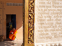 buddhist Monk resting at Monastery and temple area at Phnom Sampeau, Battambang Province, Cambodia.