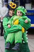 2 March 2014, Duesseldorf, Germany. Pictured: Mother proudly holding her child, both dressed in matching costumes. Costumed carnival-goers enjoy the sunshine as they celebrate with a street party in Duesseldorf, North Rhine-Westphalia, Germany.
