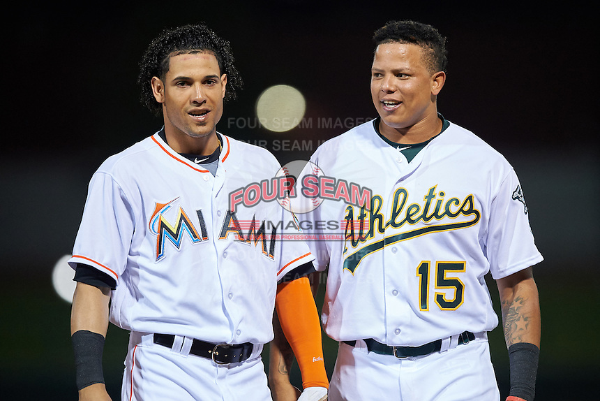 Mesa Solar Sox Yefri Perez (1), of the Miami Marlins organization, and Yairo Munoz (15), of the Oakland Athletics organization, during a game against the Peoria Javelinas on October 15, 2016 at Sloan Park in Mesa, Arizona.  Peoria defeated Mesa 12-2.  (Mike Janes/Four Seam Images)
