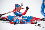 HOLMENKOLLEN, OSLO, NORWAY - March 16: (Top) Winner Alexander Legkov of Russia (RUS) and (bottom) 3rd place Ilia Chernousov of Russia (RUS) celebrate after the Men 50 km mass start, free technique, at the FIS Cross Country World Cup on March 16, 2013 in Oslo, Norway. (Photo by Dirk Markgraf)
