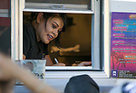 Mayra serves customers in the King Cali Catering truck during Sizzling Saturdays Food Truck event in Sparks on Saturday, July 20, 2019.