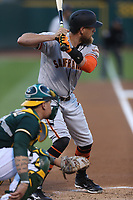 OAKLAND, CA - AUGUST 1:  Hunter Pence #8 of the San Francisco Giants bats against the Oakland Athletics during the game at the Oakland Coliseum on Tuesday, August 1, 2017 in Oakland, California. (Photo by Brad Mangin)