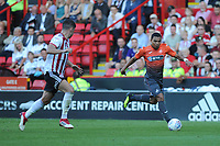 Sheffield United's George Baldock battles with Swansea City's Jefferson Montero during the Sky Bet Championship match between Sheffield United and Swansea City at Bramall Lane, Sheffield, England, UK. Saturday 04 August 2018