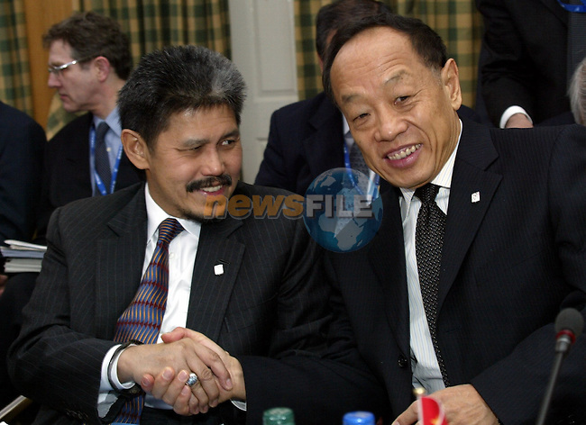 China Foreign minister,Li Zhaoxing (R) shakes hands Prince Mohamed Bolkiah Foreign minister of Brunei ,prior the 6th ASEM Foreign ministers'meeting in Straffan (Ireland) 18april 2004. AFP PHOTO TONY MAXWELL/NEWSFILE