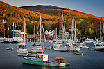 A golden autumn sunrise in Camden Harbor, Camden, ME, USA
