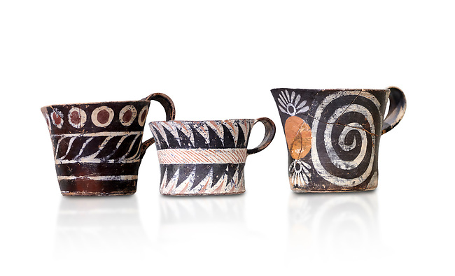 """Minoan Kamares """"eggshell"""" ware cups with  with  polychrome decorations, from set found at Phaistos Palace 1800-1600 BC; Heraklion Archaeological  Museum, white background.<br /> <br /> These cups found as parts of sets in Phaistos palace were names """"eggshell"""" ware due to the very thin walls of the cups. This style of pottery is named afetr Kamares cave where this style of pottery was first found"""