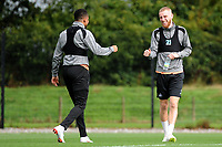 Martin Olsson and Oli McBurnie of Swansea City share a joke during the Swansea City Training Session at The Fairwood Training Ground, Wales, UK. Tuesday 11th September 2018
