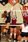 SIOUX FALLS, SD - OCTOBER 1:  Rochelle Ramharter #3 from Washington tips the ball against Erinn Temple #16 and Maggie DeJong #17 from Roosevelt in the second game of their match Tuesday night at Washington. (Photo by Dave Eggen/Inertia)