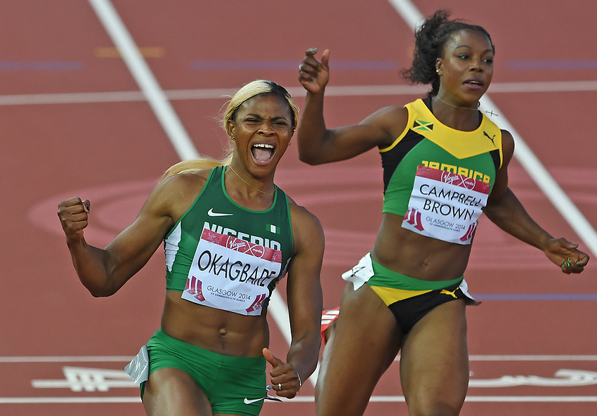 Blessing Okagbare (Nigeria), left, celebrates the women's 200m final ahead of Veronica Campbell-Brown (Jamaica)<br /> <br /> Photographer Chris Vaughan/CameraSport<br /> <br /> 20th Commonwealth Games - Day 5 - Monday 28th July 2014 - Athletics - Hampden Park - Glasgow - UK<br /> <br /> © CameraSport - 43 Linden Ave. Countesthorpe. Leicester. England. LE8 5PG - Tel: +44 (0) 116 277 4147 - admin@camerasport.com - www.camerasport.com