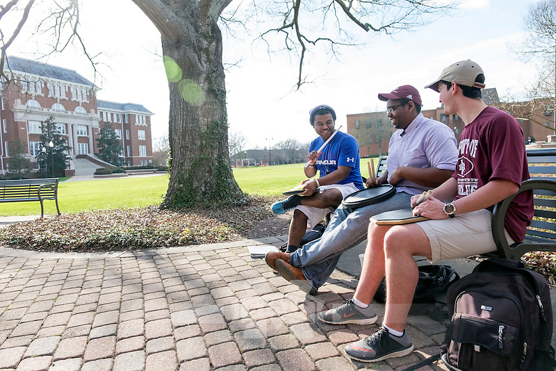 Band Drumline members practicing on the Drill Field on a beautiful Spring afternoon.  L-R: <br /> Jacobe Jones (Pre-Vet Medical Tech), <br /> Terry Roberts (Biological Sciences), and Ethan Lewis (Mechanical Engineering).<br />  (photo by Megan Bean / &copy; Mississippi State University)