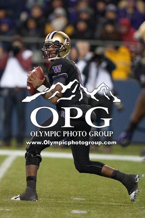 NOV 10, 2012: Washington's #17 Keith Price looks down field for an open receiver against Utah.  Washington won 34-15 over Utah at CenturyLink Field in Seattle, WA...