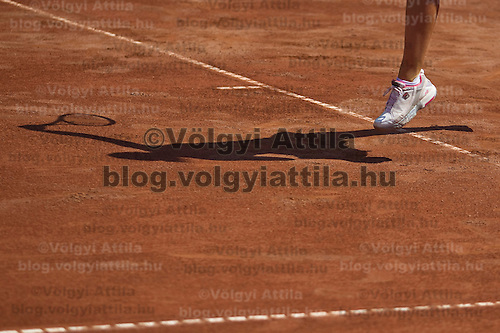 Shadow of Agnes Szavay (HUN) who plays during the Gaz de France Suez WTA tour Grand Prix international women tennis competition held at Roman Tennis Academy in Budapest, Hungary. Tuesday, 06. July 2010. ATTILA VOLGYI