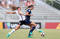 Cary, North Carolina  - Saturday July 01, 2017: Erica Skroski knocks the ball away from Ashley Hatch during a regular season National Women's Soccer League (NWSL) match between the North Carolina Courage and the Sky Blue FC at Sahlen's Stadium at WakeMed Soccer Park. Sky Blue FC won the game 1-0.