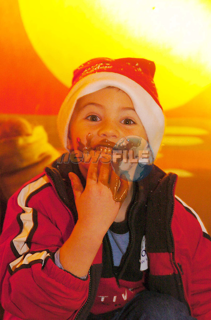 Ronan Connolly feasting on the chocolate river at the opening of Santas Kingdom in Punchestown..Picture Fran Caffrey Newsfile..Supplied by Santas Kingdom.NO REPO FEE