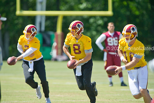 Washington Redskins quarterbacks Nate Sudfeld (2), Kirk Cousins (8) and Colt McCoy (16) practice their hand-offs as they participate in the Veteran Minicamp at Redskins Park in Ashburn, Virginia on Tuesday, June 14, 2016.<br /> Credit: Ron Sachs / CNP