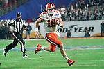 Clemson Tigers quarterback Trevor Lawrence (16) runs down field during the Fiesta Bowl game against the Ohio State Buckeyes on Saturday, Dec 28, 2019 in Glendale, Ariz.  (Gene Lower via AP)