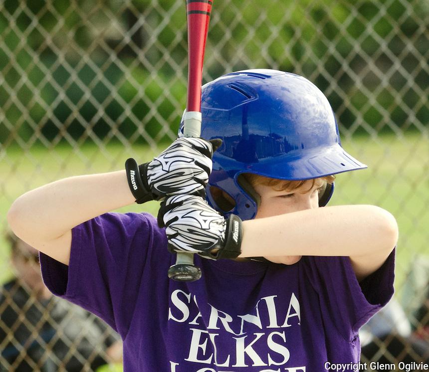 Miles Beni of Elk's Lodge Sarnia gets a base hit  while playing Lanxess during Saturday morning SMAA baseball at Germain Park.
