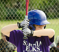Miles Beni of Elk's Lodge Sarnia gets a base hit  while playing Lanxess during Saturday morning SMAA baseball at Germain Park.