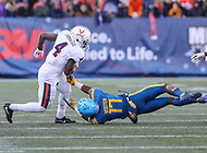 Annapolis, MD - December 28, 2017: Virginia Cavaliers running back Olamide Zaccheaus (4) avoids Navy Midshipmen cornerback Tyris Wooten (17) tackle during the game between Virginia and Navy at  Navy-Marine Corps Memorial Stadium in Annapolis, MD.   (Photo by Elliott Brown/Media Images International)