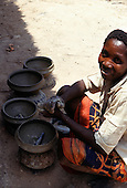 Kirambo, Tanzania. Woman making pots for domestic use.