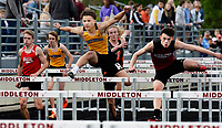 Middleton's Casey Hellenbrand (right) works to overtake DeForest's Marlon Cystrunk (center) to win the 110 meter hurdles during the Wisconsin WIAA Division 1 high school track and field regional on Monday. Hellenbrand finishes first in 15.34 seconds; Cystrunk second, in 15.57 seconds.