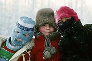 Talkeetna School, Alaska, U.S.A, January 1989. A sudden cold wave struck Alaska resulting to the temperature falling under 50 degrees Centigrade (58 degrees Fahrenheit). Three Pupils.