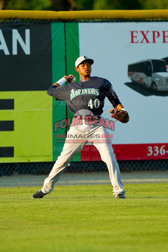 Jesus Ugueto (40) of the Pulaski Mariners throws the ball in from left field during the Appalachian League game against the Burlington Royals at Burlington Athletic Park on June20 2013 in Burlington, North Carolina.  The Royals defeated the Mariners 2-1 in 13 innings.  (Brian Westerholt/Four Seam Images)