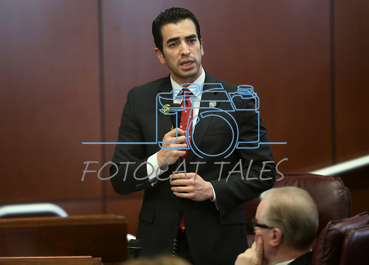 Nevada Sen. Ruben Kihuen, D-Las Vegas, works on the Senate floor at the Legislative Building in Carson City, Nev., on Tuesday, May 21, 2013. .Photo by Cathleen Allison